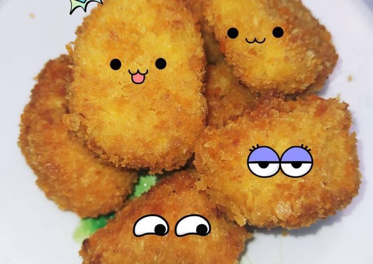 Bagaimana Menyiapkan Nugget Ayam Wortel Jagung Anti Gagal