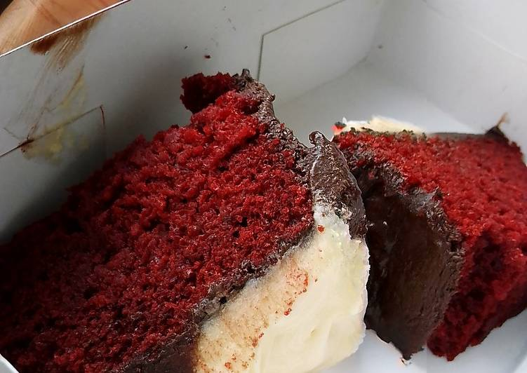 Red velvet cake frosted with homemade chocolate and cream cheese