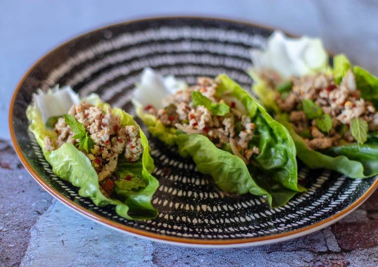 Larb chicken in lettuce cups