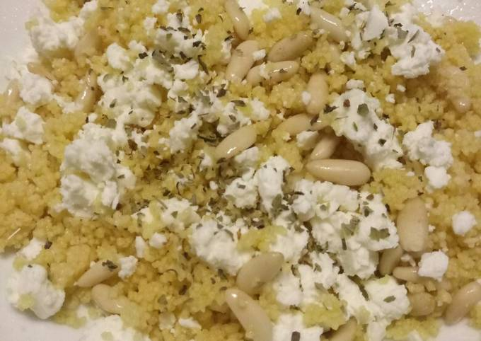 Cous cous salad with feta cheese and pine nuts