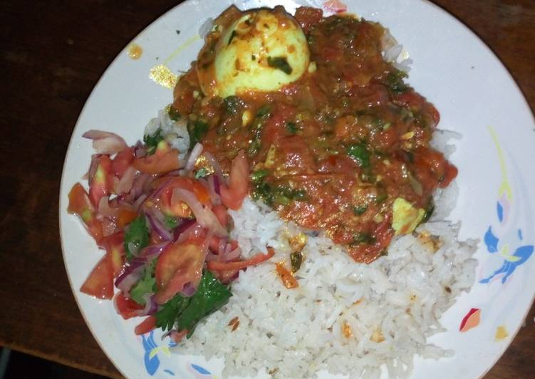 Spicy egg curry and cumin rice