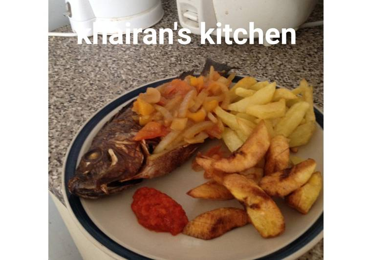 Chips,plantain and grilled tilapia fish