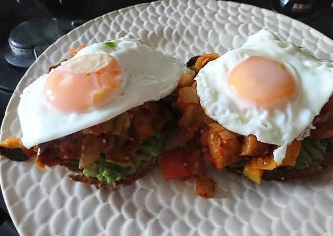 Fried Eggs on Ratatouille on spicy Avocado on Sourdough..