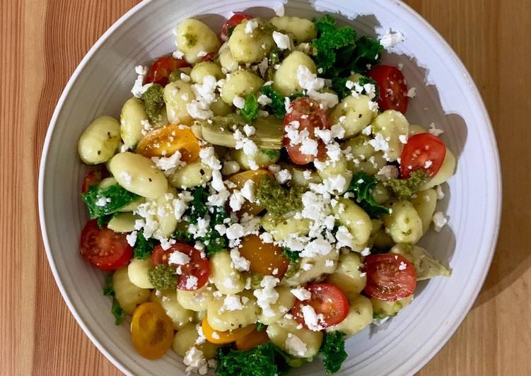 Use Food to Improve Your Mood Gnocchi with pesto, artichoke, tomatoes and feta