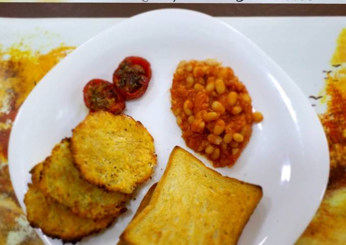 Baked Beans with toasted Bread,Hash brown & grilled tomatoes