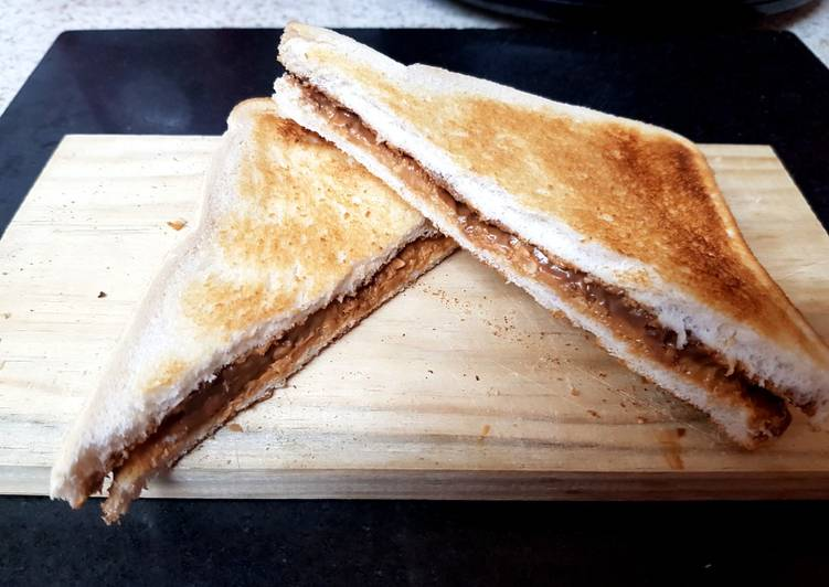 Easiest Way to Prepare Appetizing My Peanut Butter & Cadbury,s Caramel Chocolate Toast Sandwich.😘
