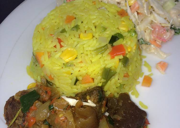 Choosing The Right Foods Will Help You Stay Fit And Also Healthy Fried rice with peppered goat meat and coleslaw