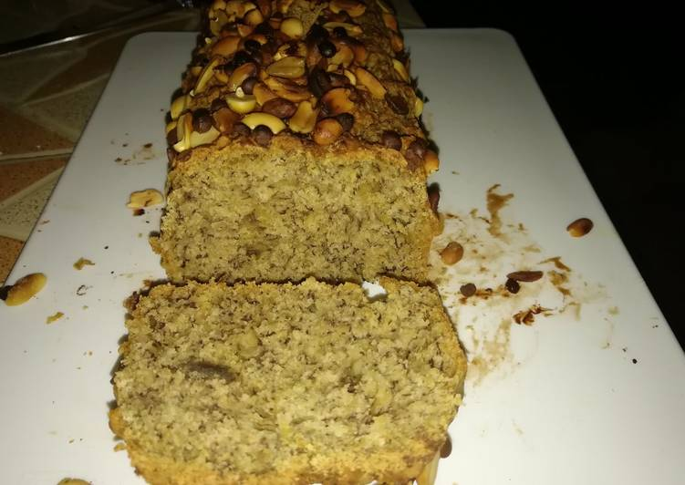 Banana bread with nuts and chocolate chips toppings.