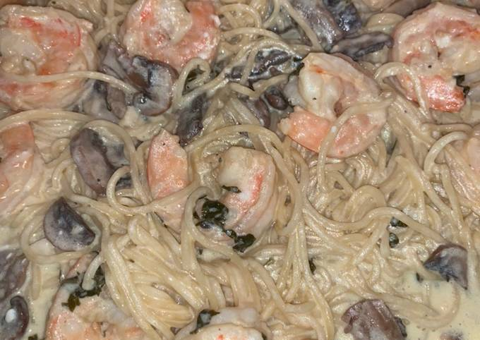 Shrimp and mushroom pasta with a basil white wine cream sauce