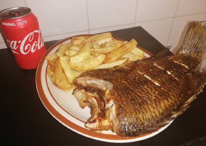 Grilled Bream fish and fried potato chips