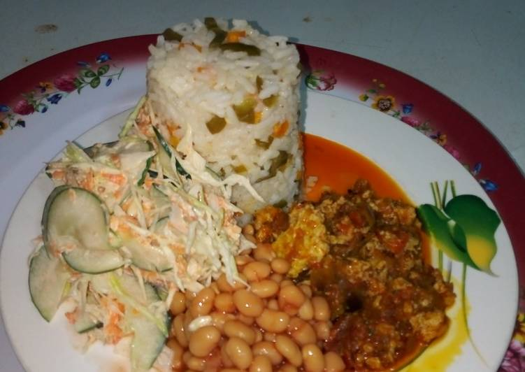 Steps to Make Quick Buttered Veggie Rice, Palm oil egg sauce,baked beans and salad