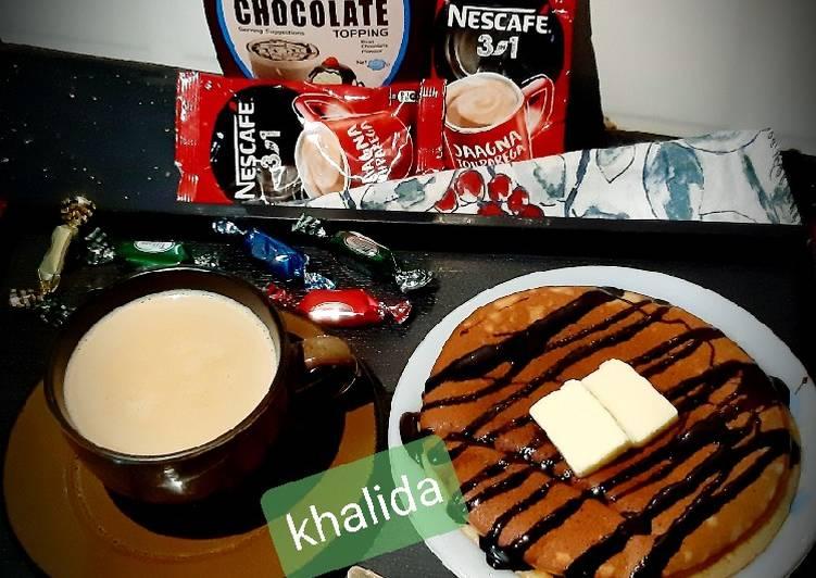 Banana pancakes chocotopping with coffee