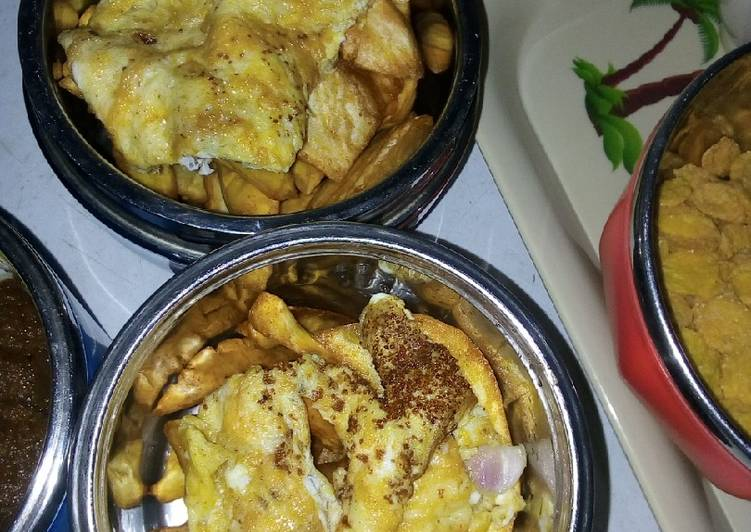 Fried potatoes chips with egg