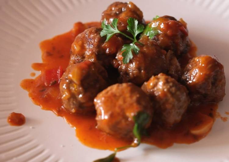 Meatballs cooking in an EVOO from Spain Sauce