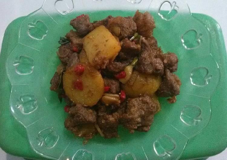Rendang kambing with kentang