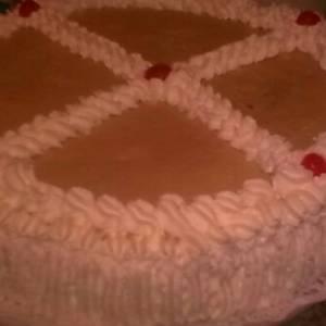 Tarta de crema pastelera con licor de crema catalana  y nata