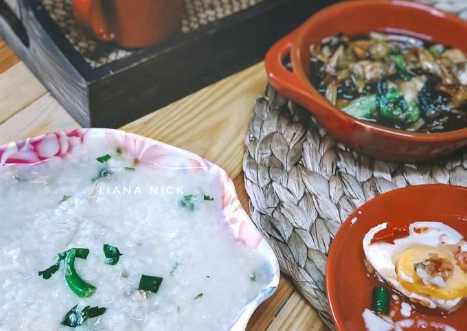 Bubur nasi telur masin air asam dan ikan masin tumis