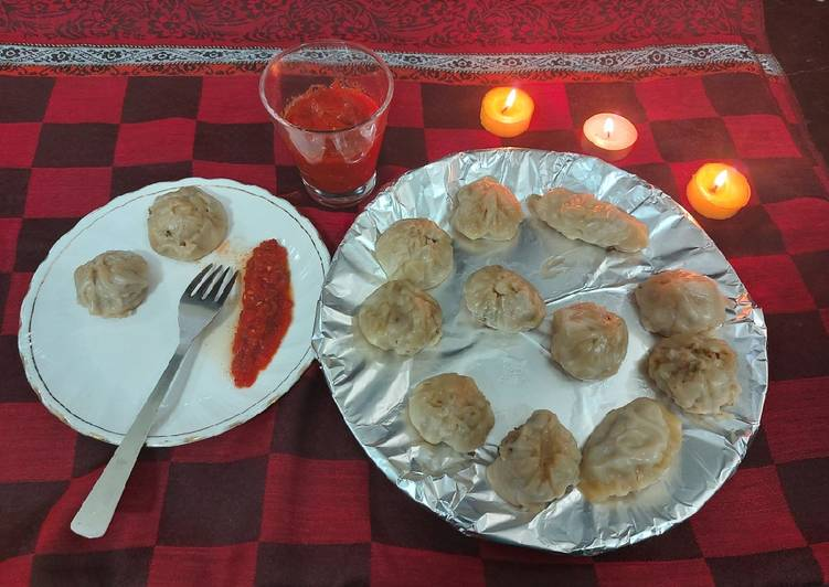Chicken momos with spicy sauce