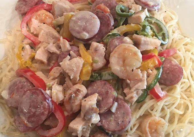 How to Make Appetizing Chicken, Shrimp, & Sausage with Alfredo Sauce on Angle Hair Pasta