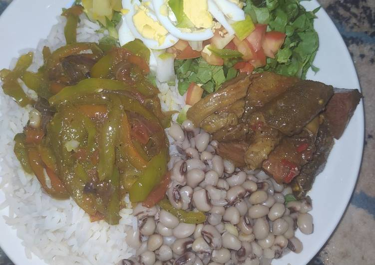Rice and beans,salad,vegatable stir fry and beef sauce