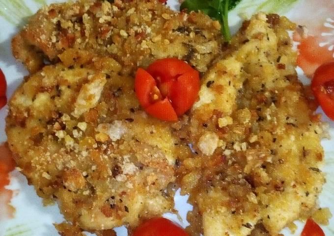 Fette di petto di pollo,panate con dadolata, di zucca, patate, e pan grattato, gratinati in forno