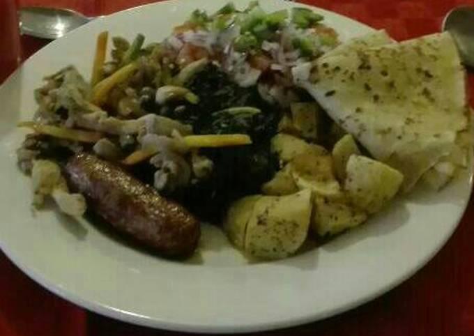 African breakfast sausages, pancakes, salad with kachumbari