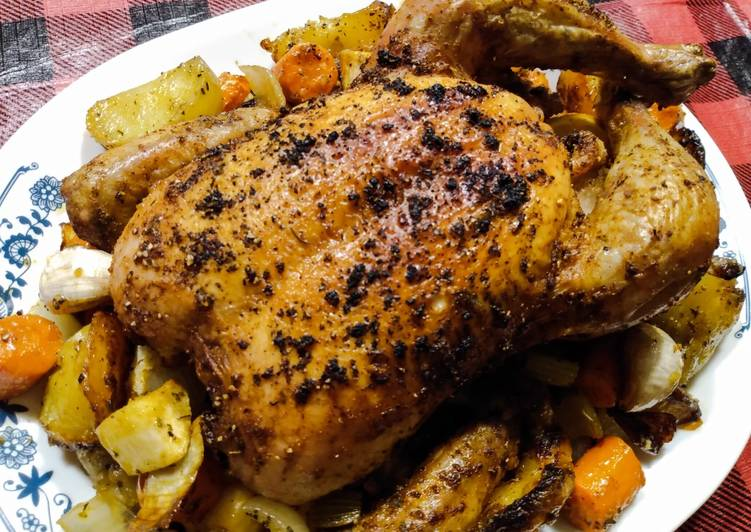 One tray roast whole chicken, potatoes and veg