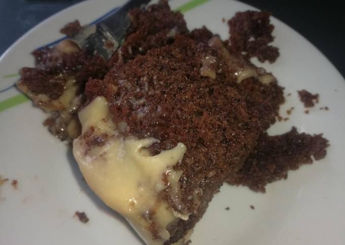 Chocolate poke cake with white chocolate frosting