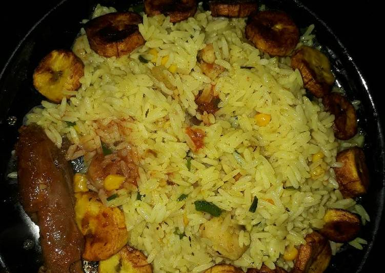 Fried rice plantains and fried chicken