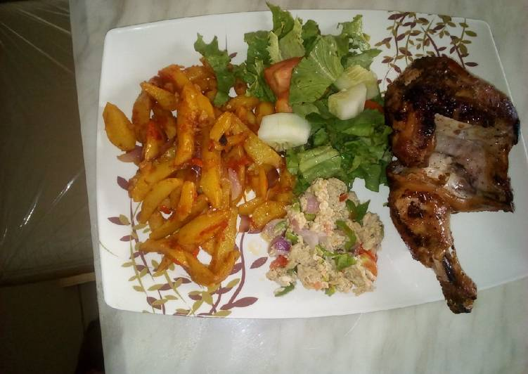 Sauteed potatoes with scrambled eggs and grilled chicken