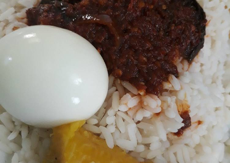 Rice,egg and ripe plantain