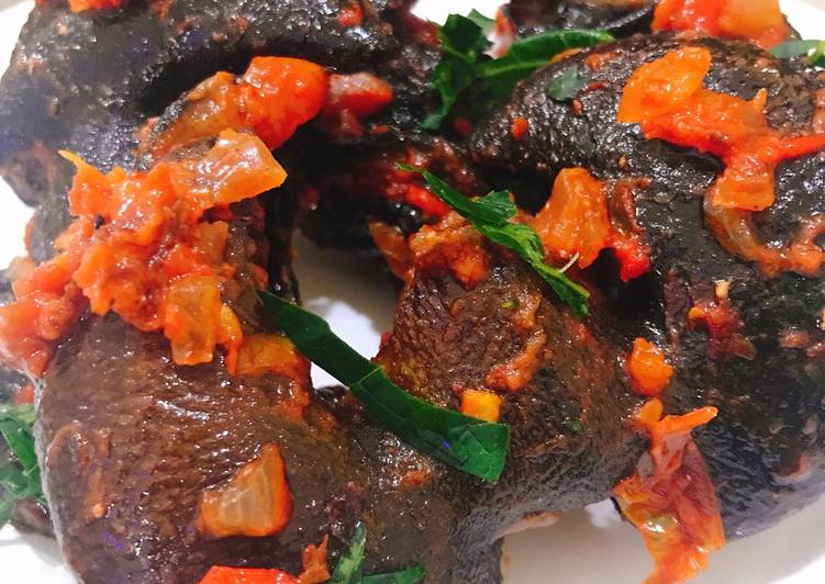 Spicy fried snail in sauce