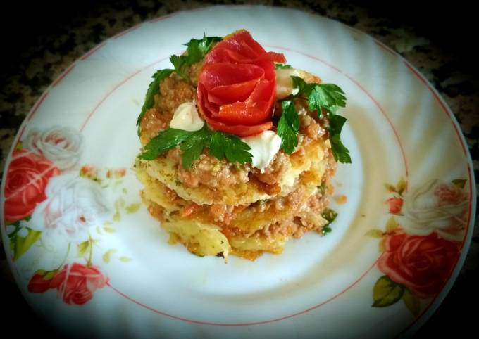 Sandwich with grated potato and chopped meat,cheese,tomato