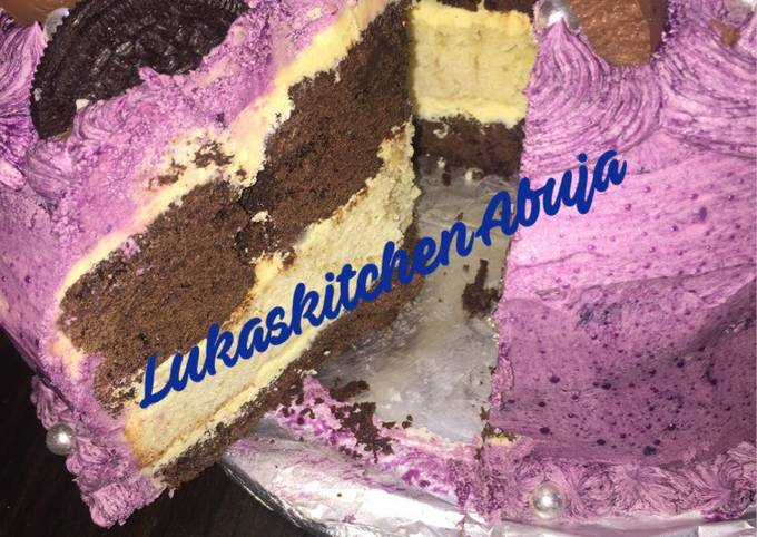 Easy Chocolate And Vanilla Birthday Cake with purple frosting