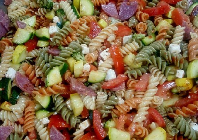 Pasta salad with feta cheese and salami