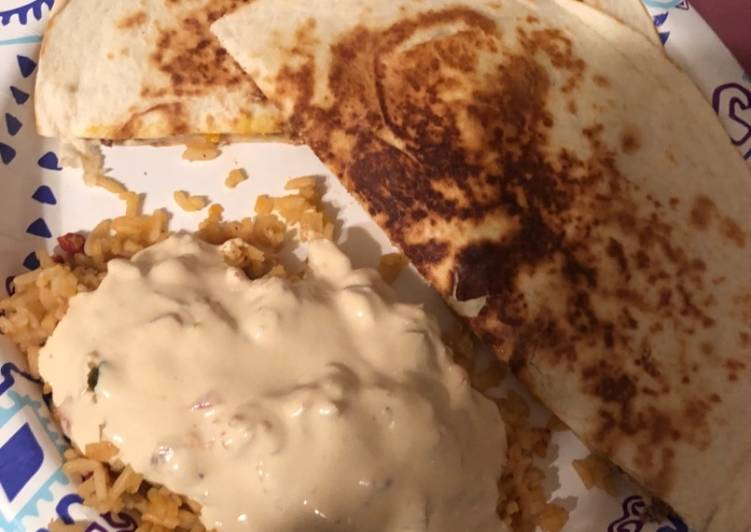 Nacho quesadillas and queso covered Spanish rice