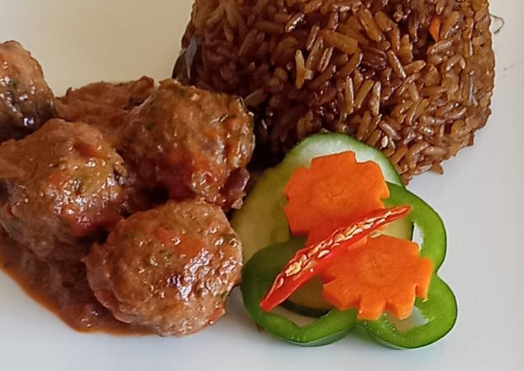 Meat balls in tomato Concasee' with stir fried rice