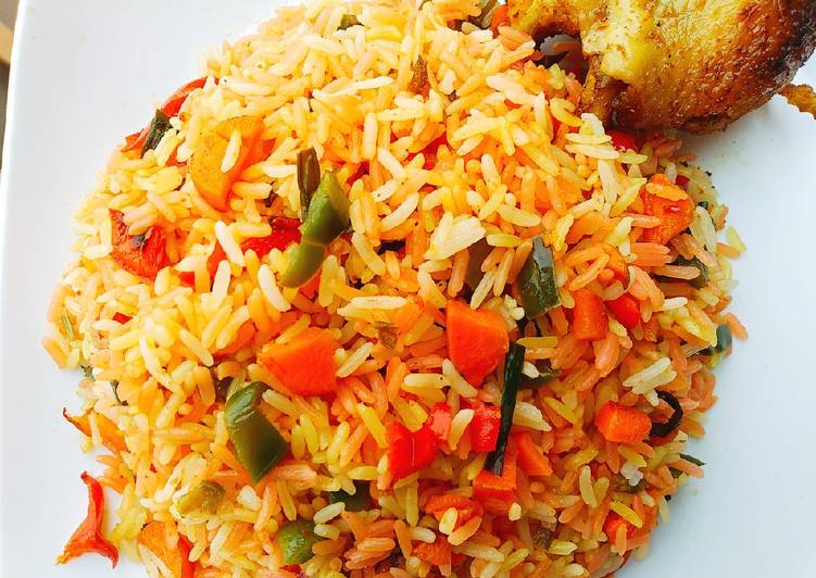 #Christmas #Lagos Colorful fried rice with roasted Chicken