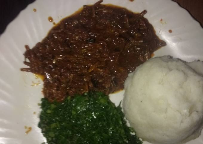 Omena stew with ugali and kales