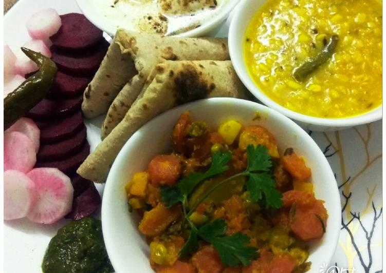 Gajar Matter veg,Dhuli Urad dal with plain curd, chapati, saled