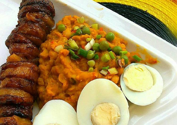 Beans paired with fried plantains and hard boiled eggs
