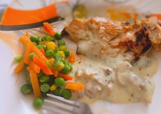 Grilled chicken with mushroom sauce and stir fry veggies