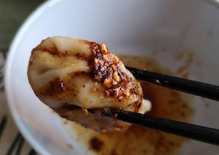 White bean dumplings dip in sichuan dipsauce