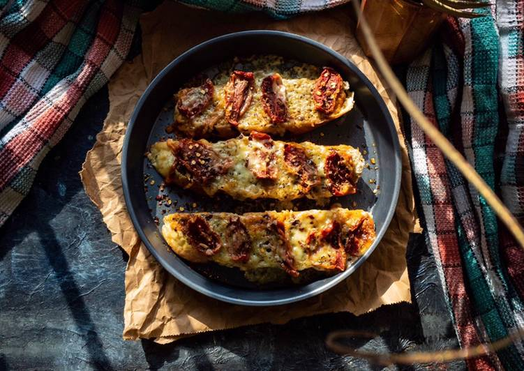 Basil pesto bruschetta with sun dried tomatoes and freeze dried cheese flakes