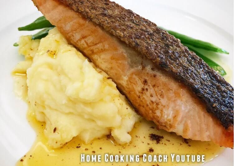 Crispy skin Salmon with mash, greens and lemon butter sauce