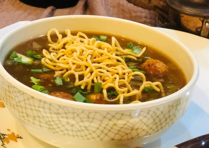 Whosayna's Chicken Manchow Soup topped with Manchurian balls