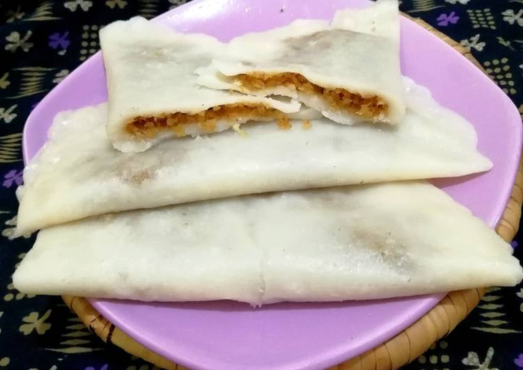 African Food Ella ada Steamed rice Pancakes With Coconut & Jaggery Filling