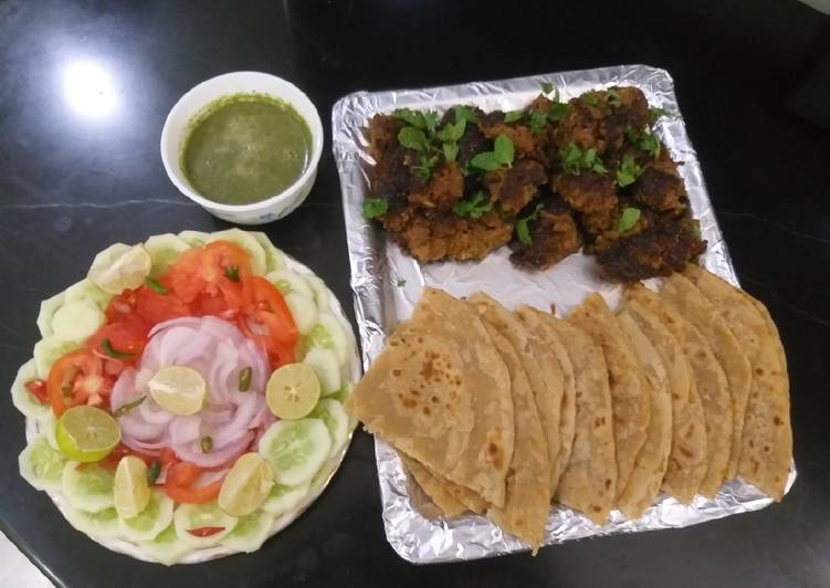 Mutton kababs and parathas with curd chattny and salad