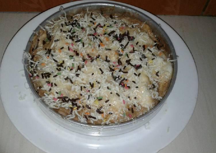 Roti tawar mix with banana and white coffee