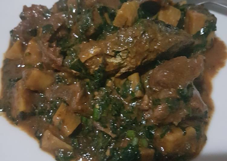 Platain porridge with diced meat, ugu leaves & oven grilled fish